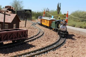 Superstition Mountain Museum Railroad - Train cars moving along the tracks.