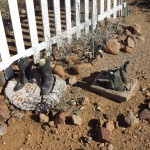 Boots left in concrete, at the entrance to Boot Hill