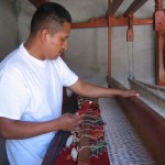 Porfirio Guiterrez, traditional Zapoteca weaver, working on weaving loom